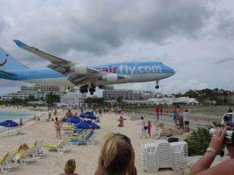 Saint Martin Airport low altitude over Caribbean beach