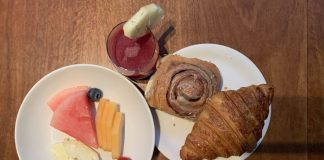 wellness juice, delectable home-made cinnamon scroll and croissant