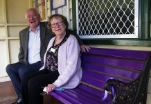 Mick Murray on purple bench