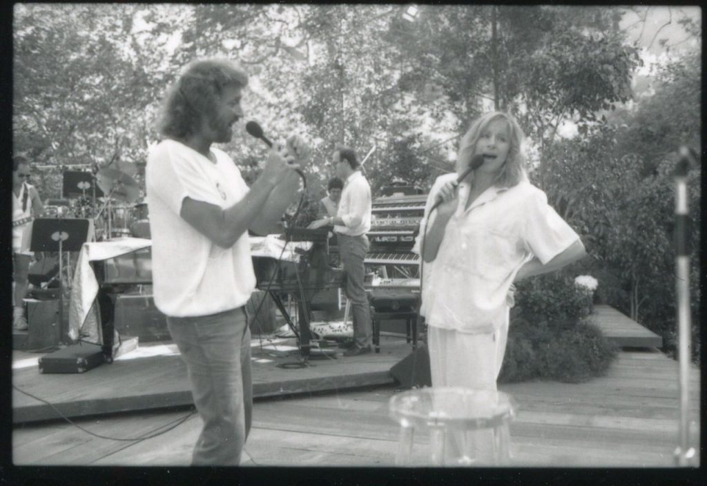 Barry Gibb and Barbra Streisand singing together