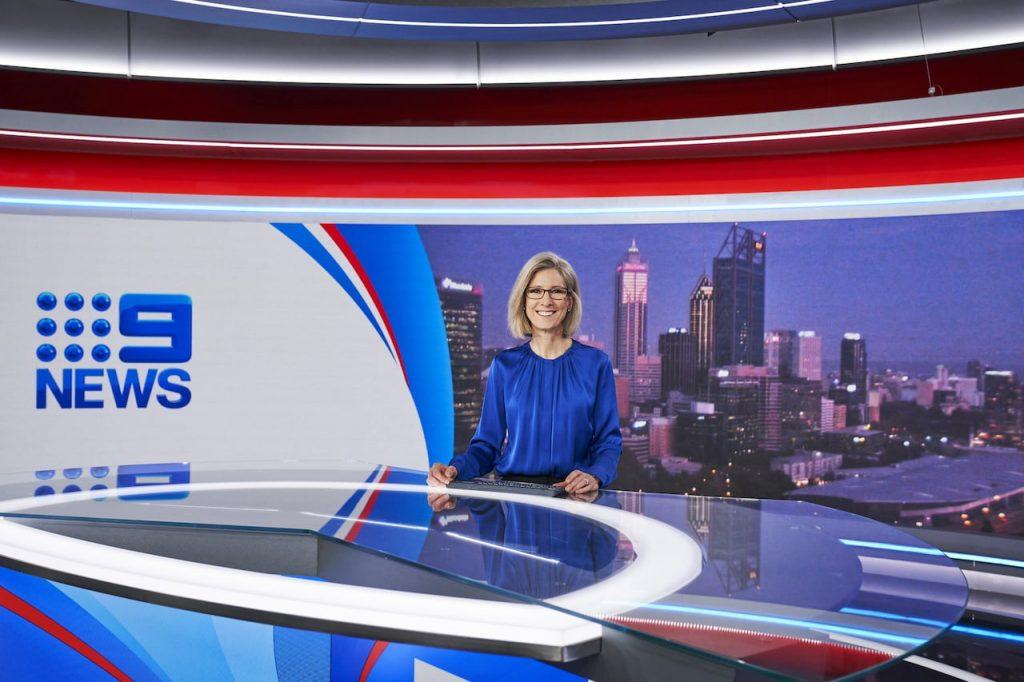 Monika Kos on the news desk