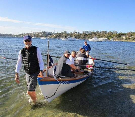 John Longley out early on the Swan River with his skiff crew