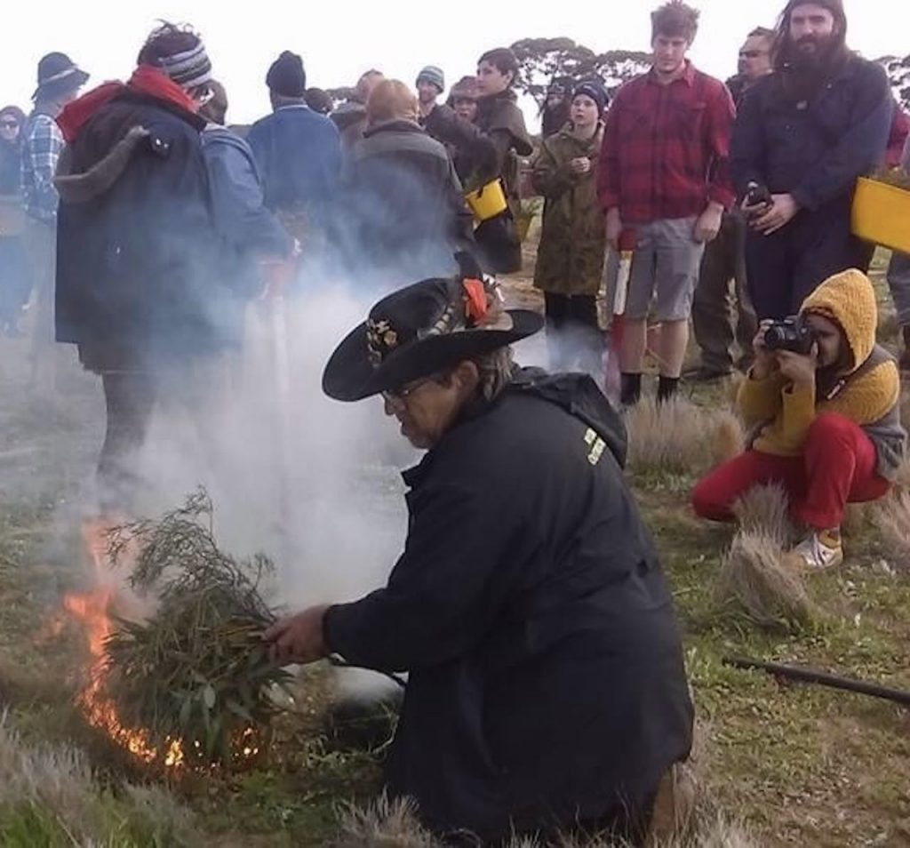 Husband Mort doing a smoking ceremony in the bush