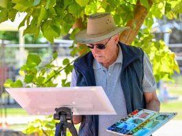 Roy Harris at work at his easel