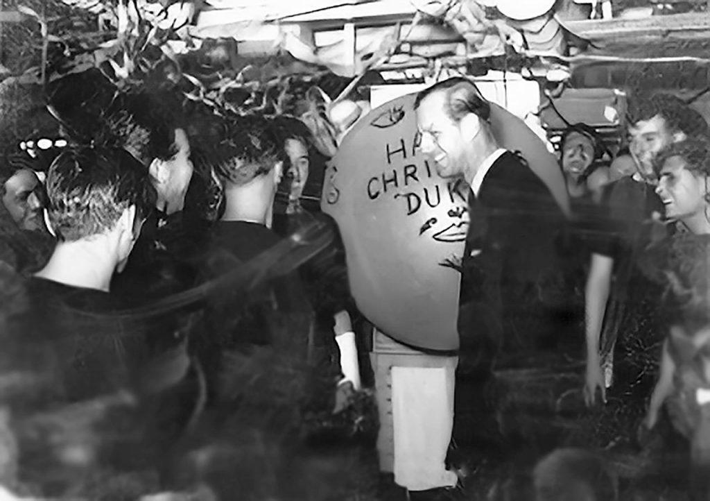 the Duke of Edinburgh greets sailors at Christmas