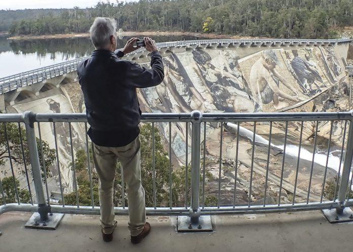 Guido van Helten's 8,000 square metre mega mural on the Wellington Dam wall