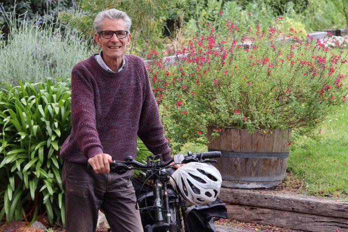 Rod Mitchell standing next to his bike