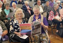 Mandurah seniors enjoying the September edition of Have a Go News at the Leslie Street Centre